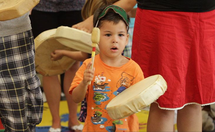 Young Child Playing Drum